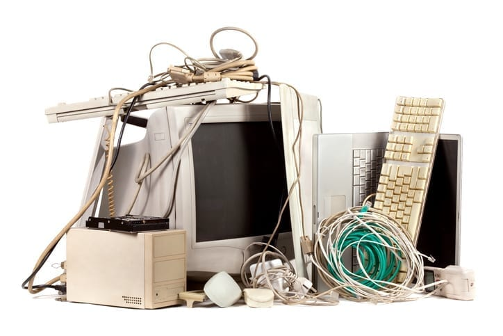 Pile of used, obsolete electronics. windows 7 - Old IT system - Why you need to keep your IT systems up to date blog - Old IT system - Blog | Cloud Edge